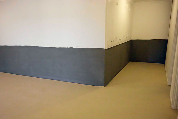 Finished wall completed with cementitious membrane, ready for painting.