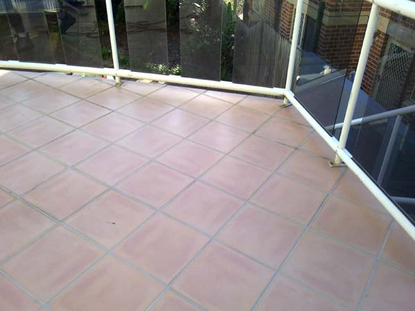 This floor had the grout removed at some stage, where a failed attempt at using a rigid polymer sealer to fill the voids between the tiles was done.